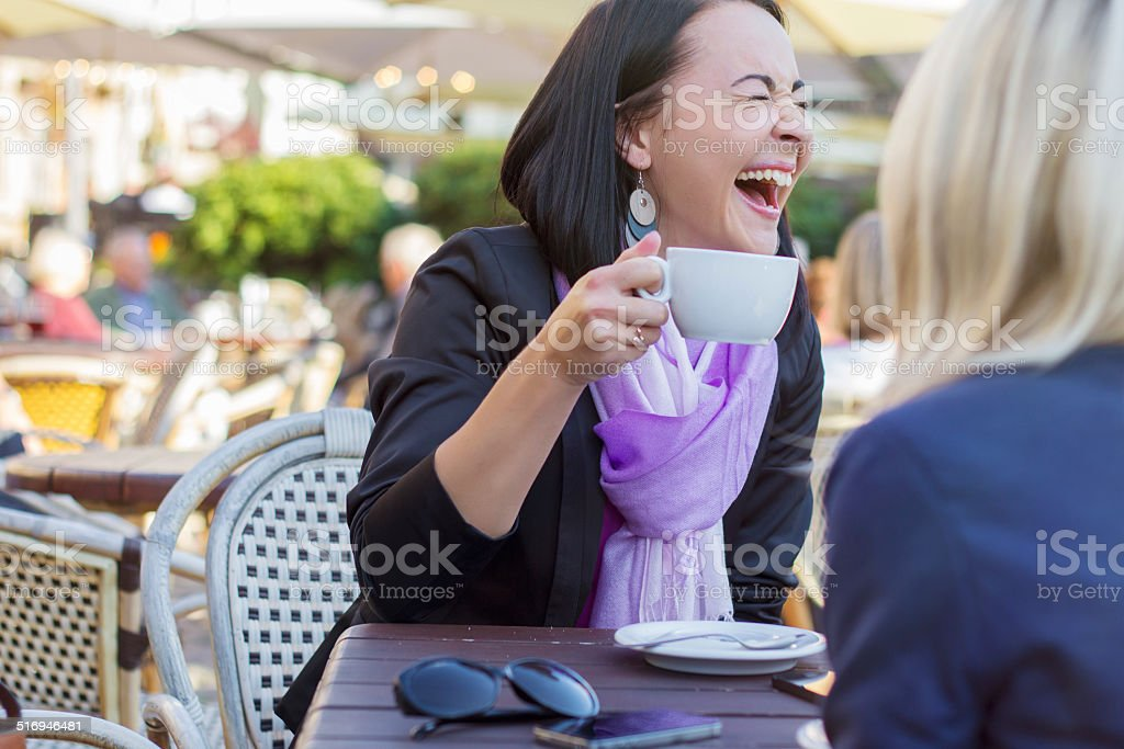 Two female friends having good time together stock photo