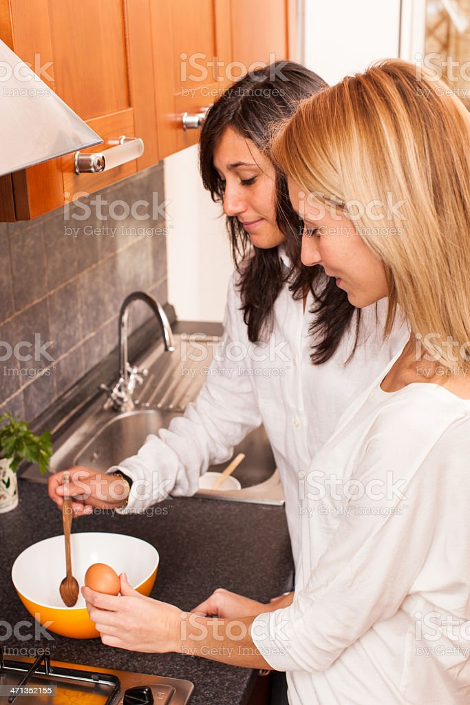 Two Female Friends in the Kitchen royalty-free stock photo