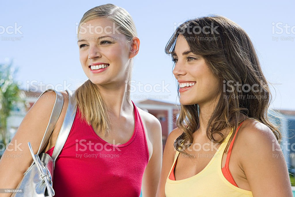 Two female friends on vacation stock photo