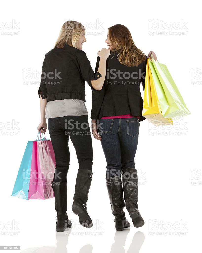Two female friends walking with shopping bags royalty-free stock photo