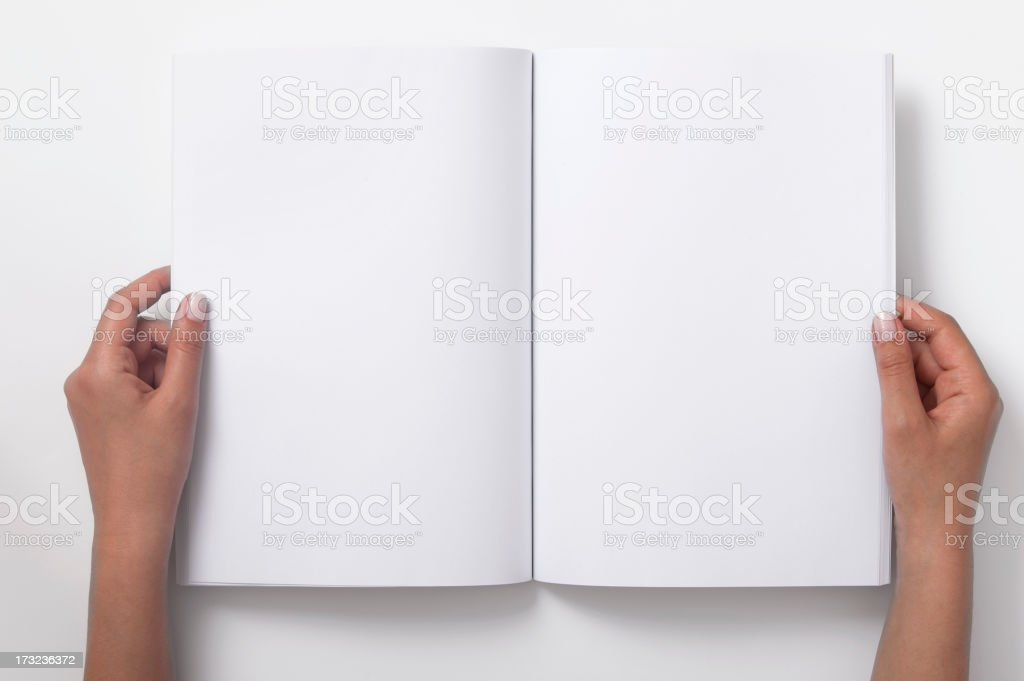 Two Female Hands Holding Open A Blank Magazine stock photo