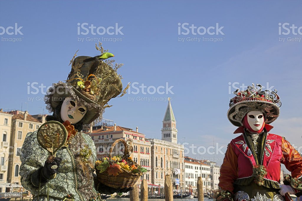 Two female masks and Venice skyline with campanile (XXL) royalty-free stock photo
