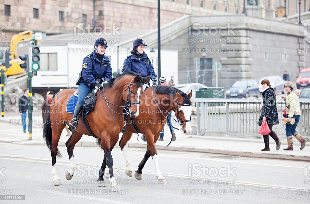 Two female mounted police clearing the road. stock photo