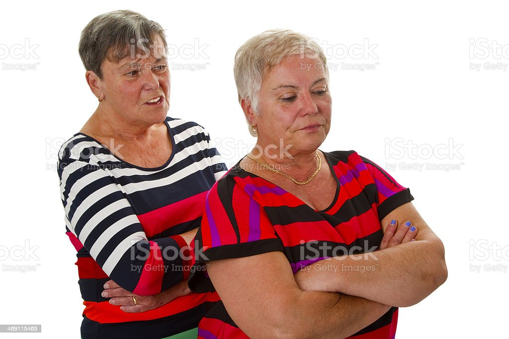 Two female seniors in dispute royalty-free stock photo