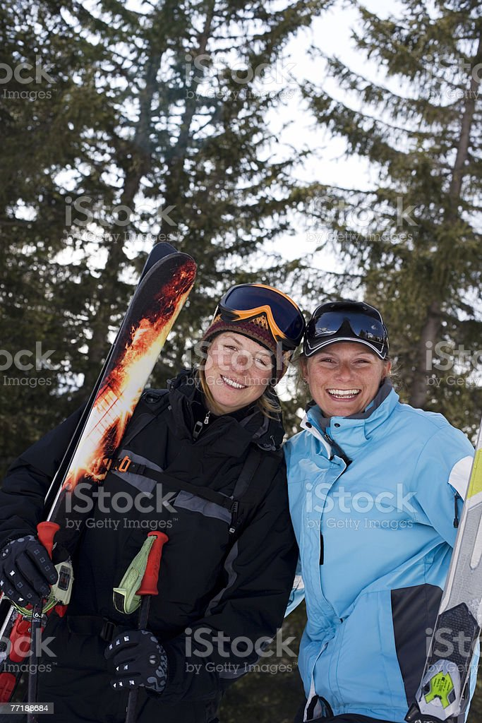 Two female skiers smiling at the camera royalty-free stock photo