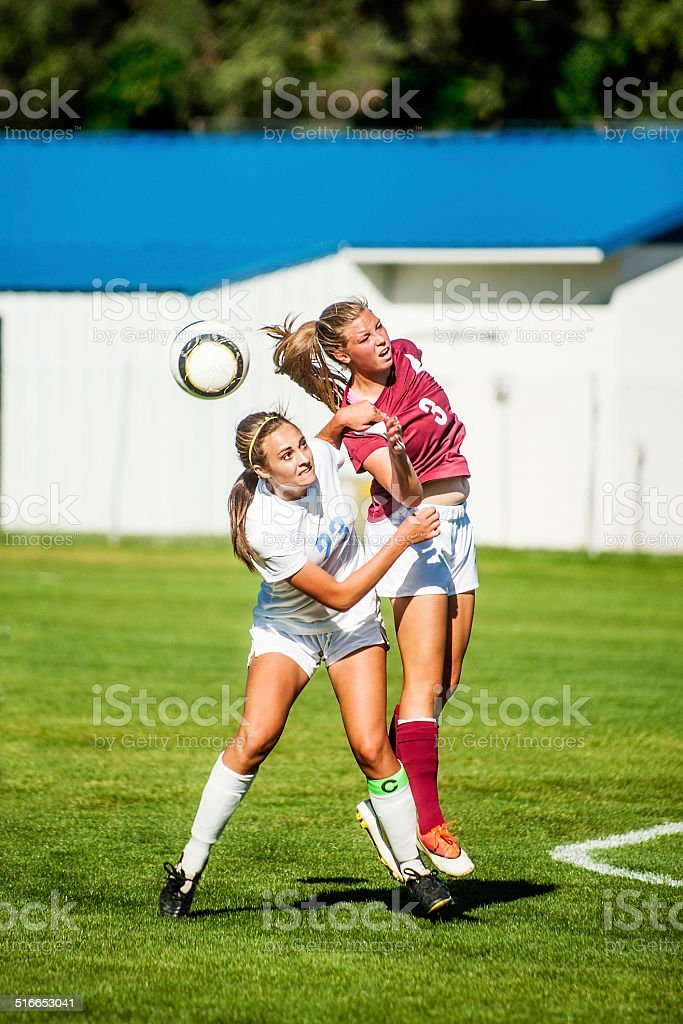 Two Female Soccer Players in Header Ball Redirect stock photo