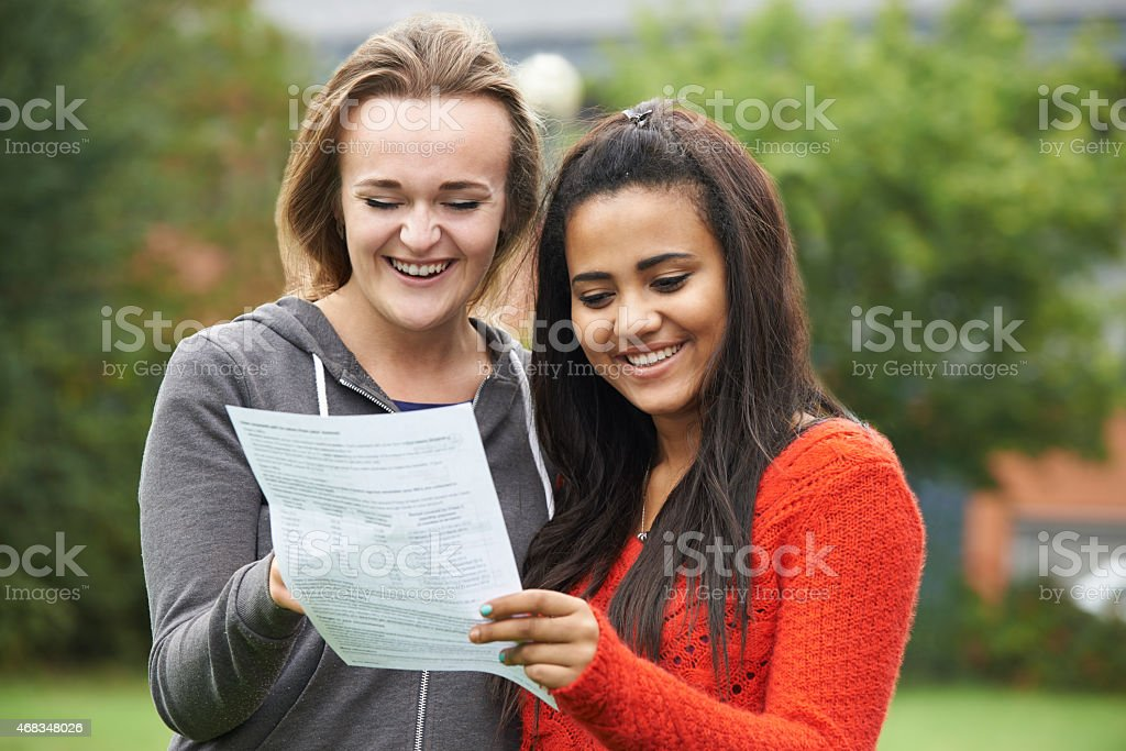 Two Female Students Celebrating Exam Results Together stock photo