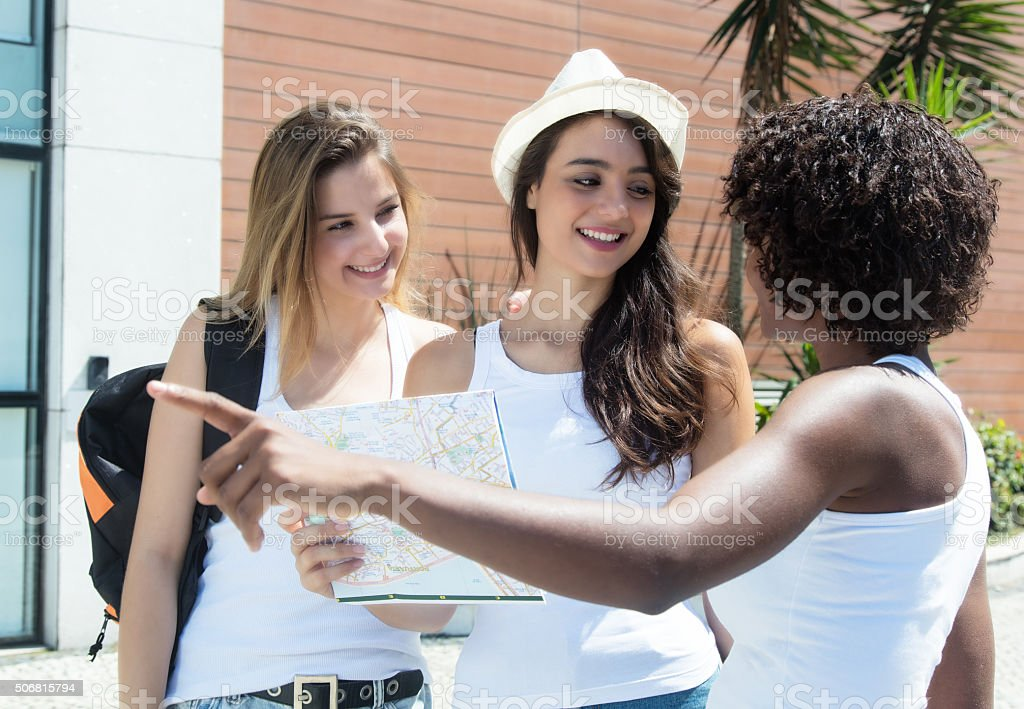 Two female tourists asking for the way stock photo