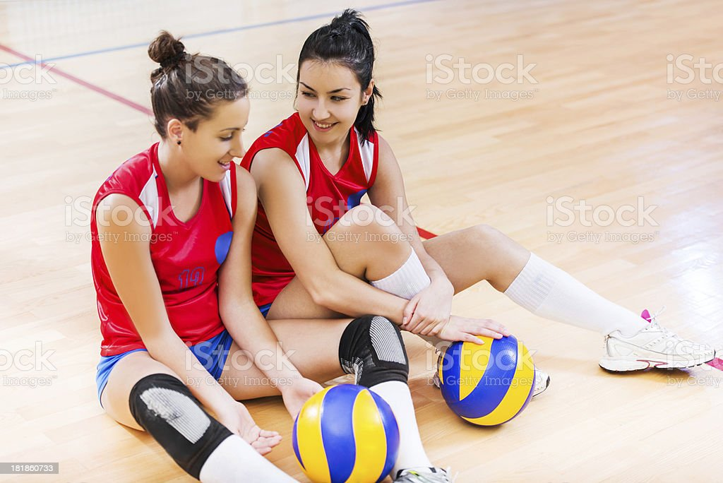 Two female volleyball players communicating. royalty-free stock photo