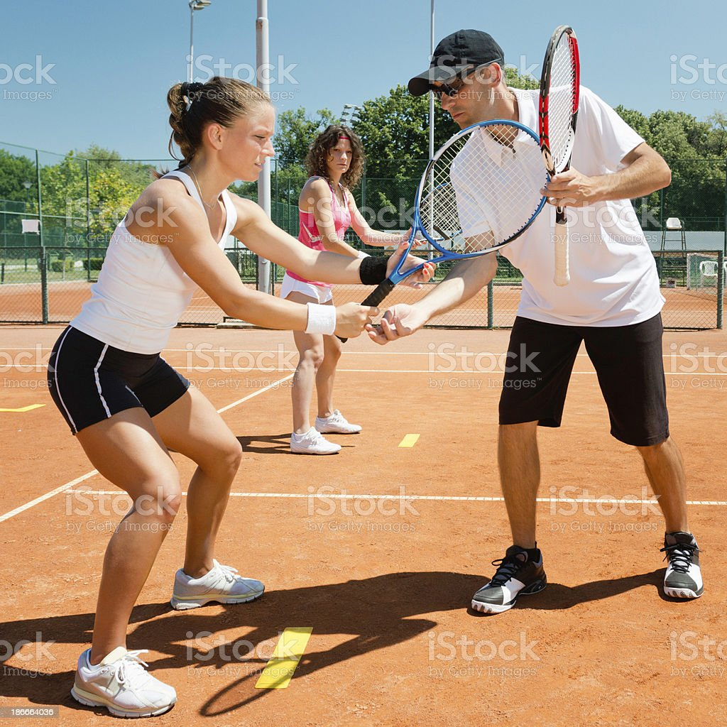 Two females taking tennis lessons  royalty-free stock photo