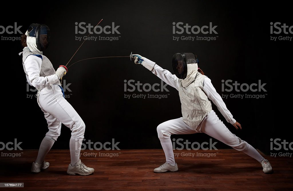 Two fencer women royalty-free stock photo