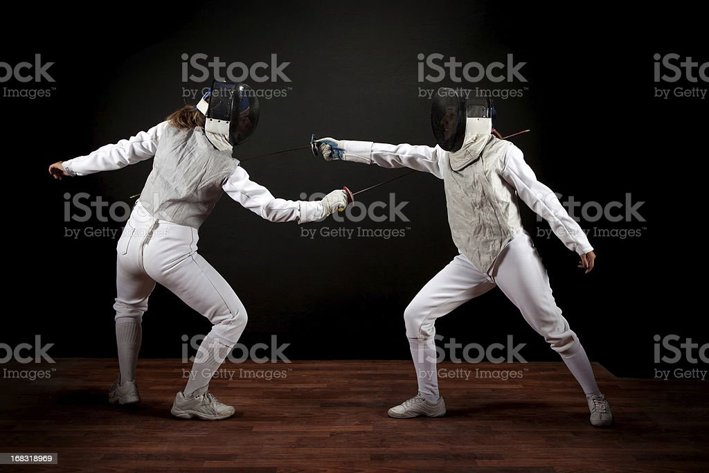 Two fencer women stock photo