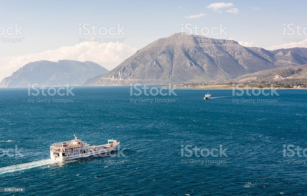 Two ferry boats sailing towards eachother stock photo