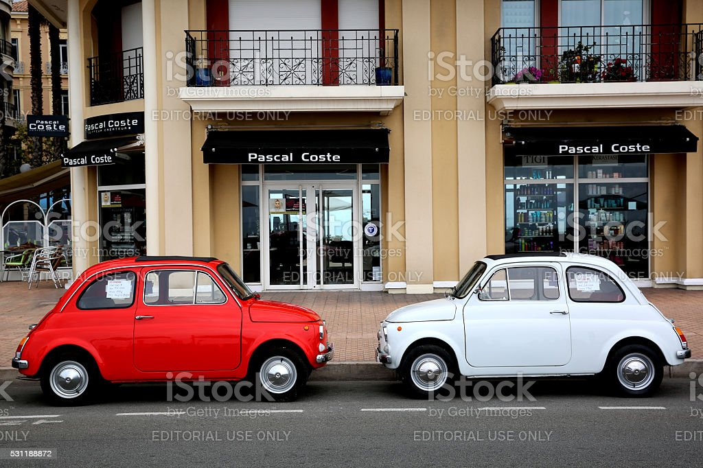 Two Fiat 500 Parked in The Street in Menton, France stock photo