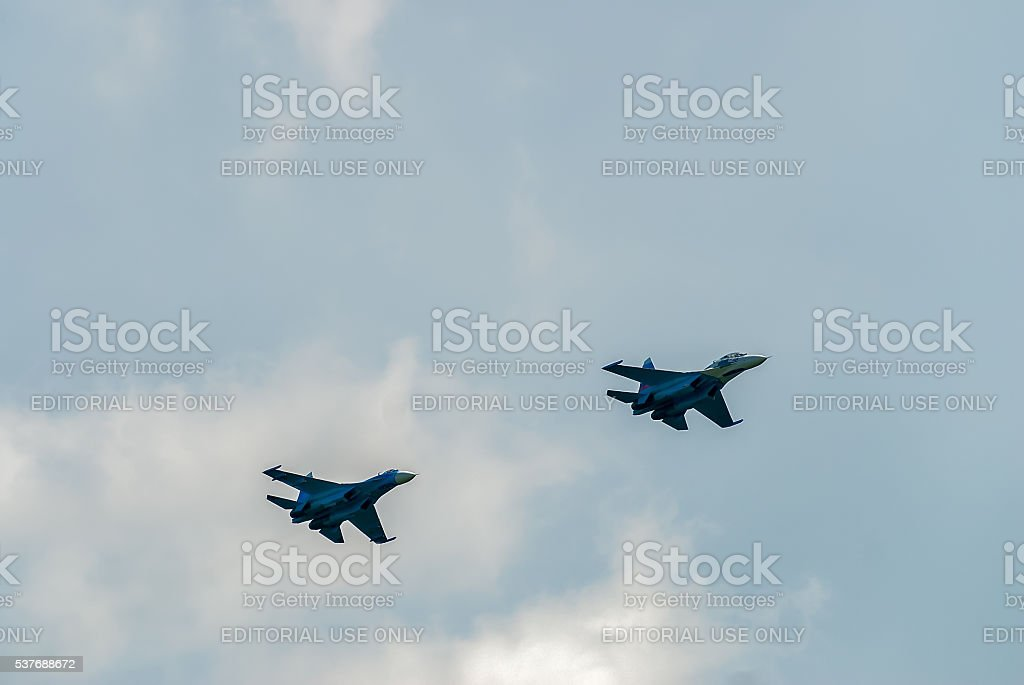 Two fighter SU-27 put bend stock photo