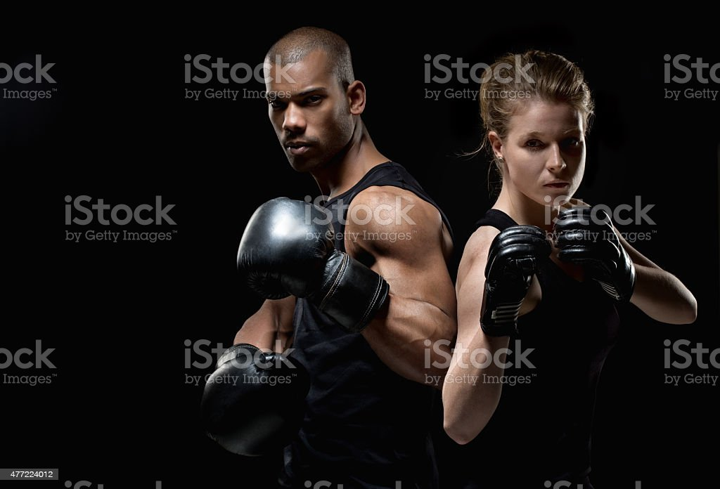 Two fighters posing with raised fists stock photo