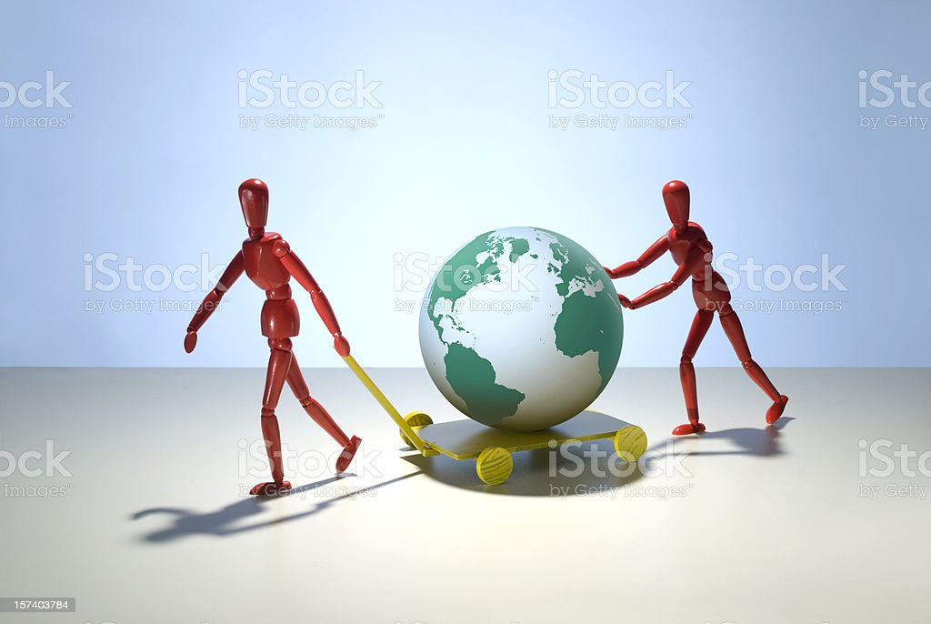 Two figures move the earth. stock photo
