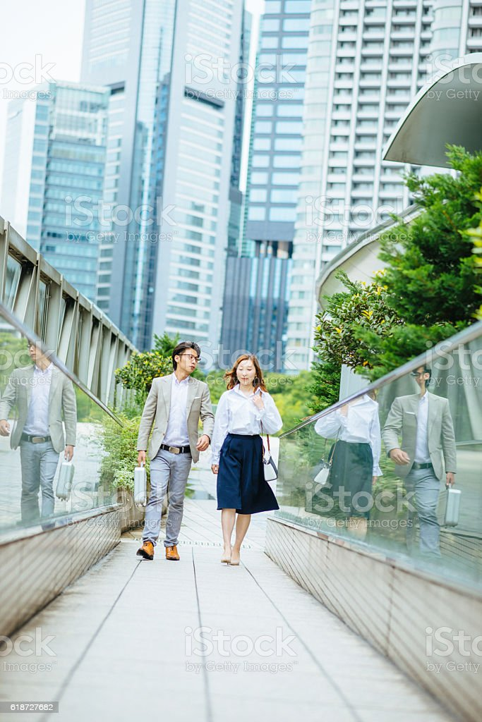 Two financial advisors in Japan, in financial district stock photo