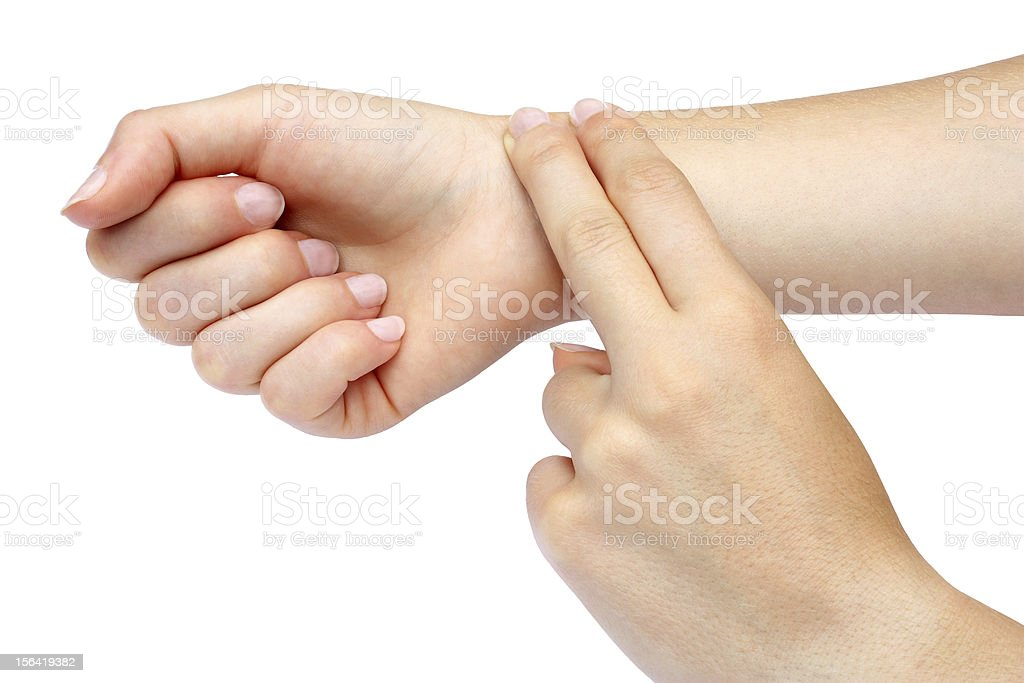 Two fingers checking pulse on wrist royalty-free stock photo