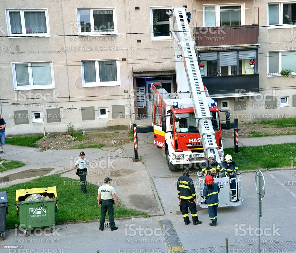 Two firefighters get aboard into telescopic boom basket. stock photo