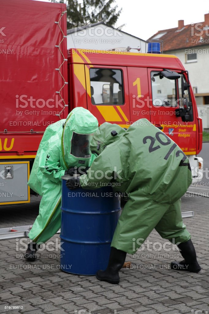 Two firefighters in heavy protective suits stock photo