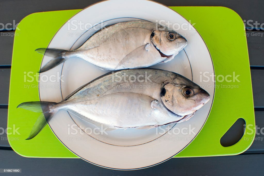 two fish on a plate stock photo