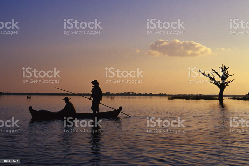 Two fisherman in a canoe royalty-free stock photo