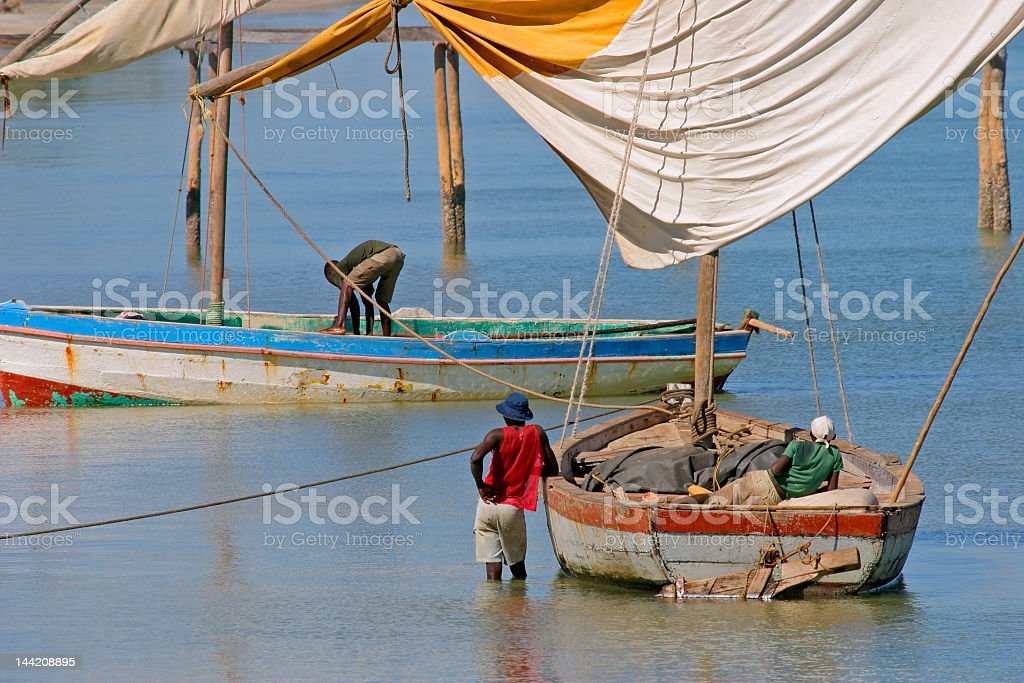 Two fishermen in the water located in Mozambique  stock photo