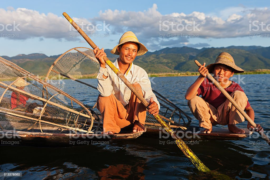 Two fishermen on Inle Lake, Myanmar stock photo