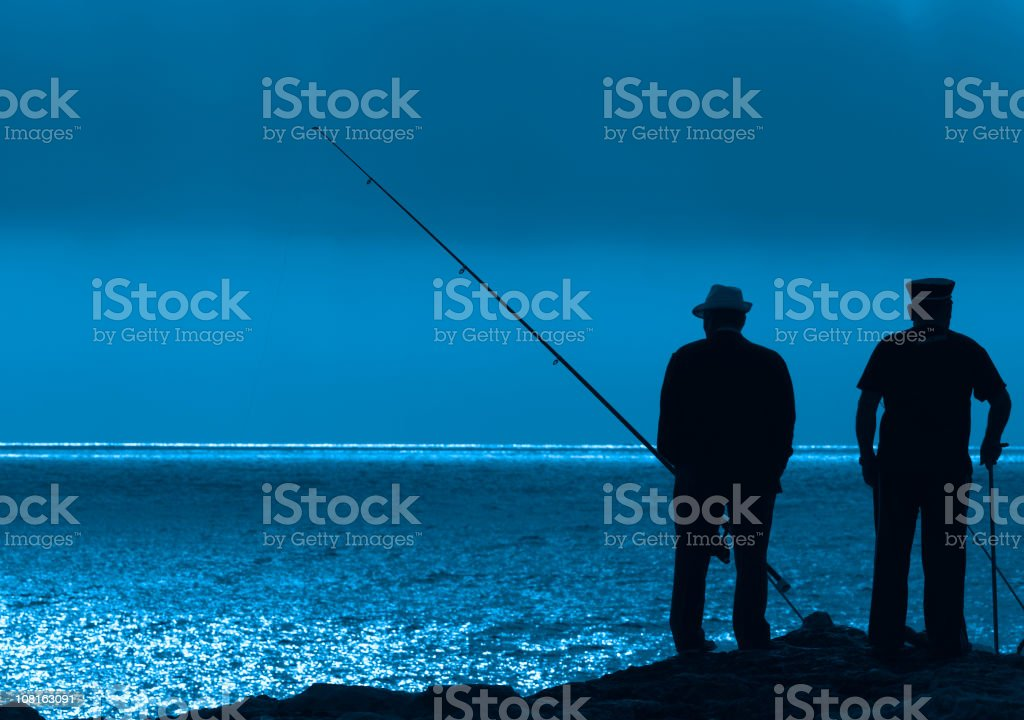 Two Fishermen SIlhouette royalty-free stock photo