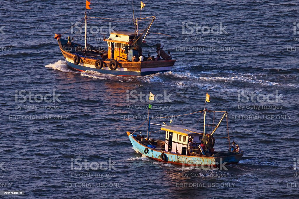 Two fishing boat sailing to sea for fishing stock photo