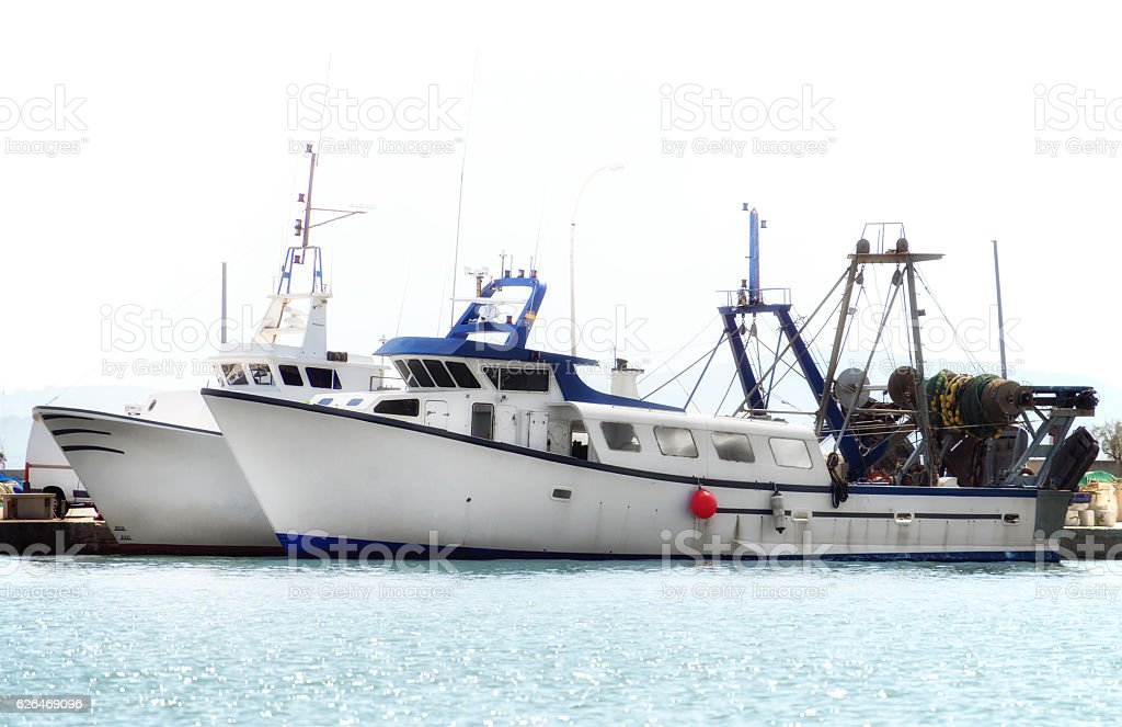 Two fishing vessels in the port. stock photo