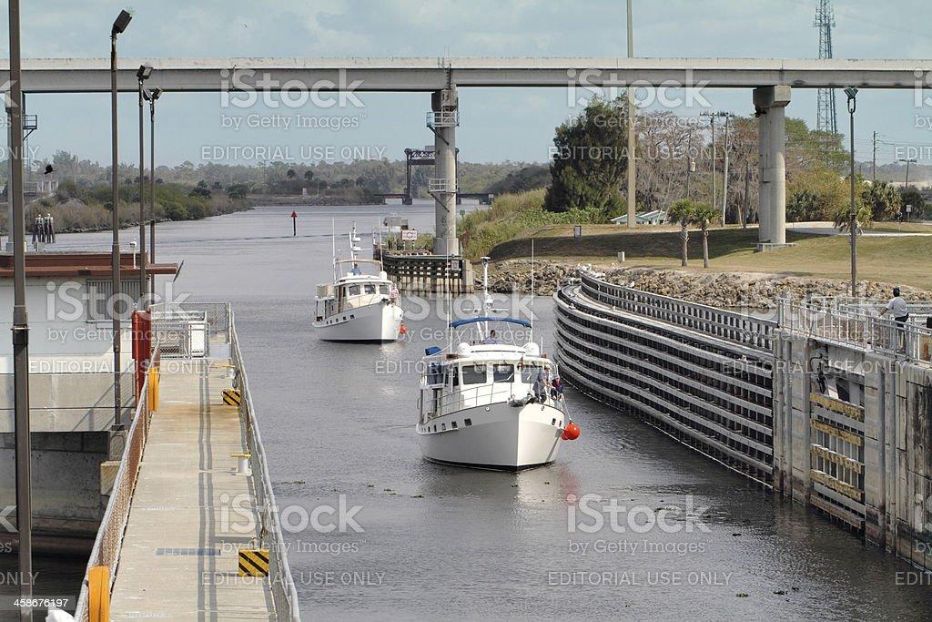 Two fishing yatchs enter the Port Mayaca Lock and Dam stock photo