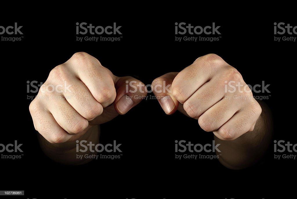 Two fists isolated on black background royalty-free stock photo