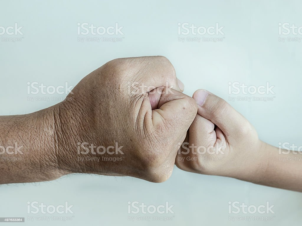 two fists of a man and a boy stock photo