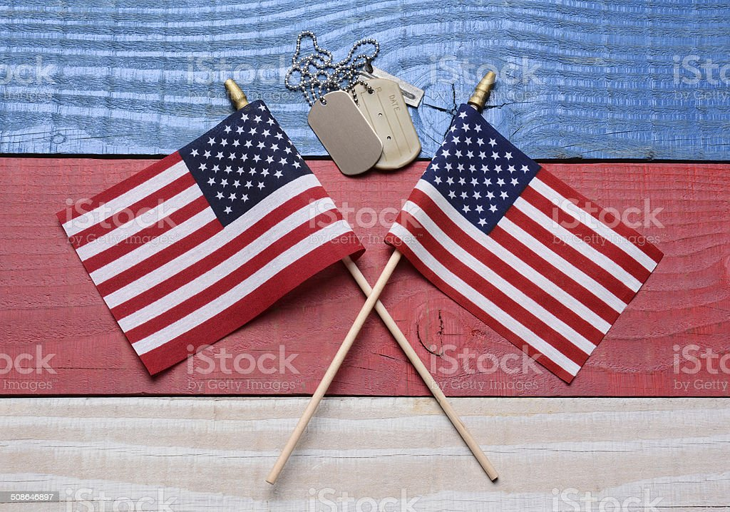 Two Flags and Dog Tags on Patriotic Table stock photo