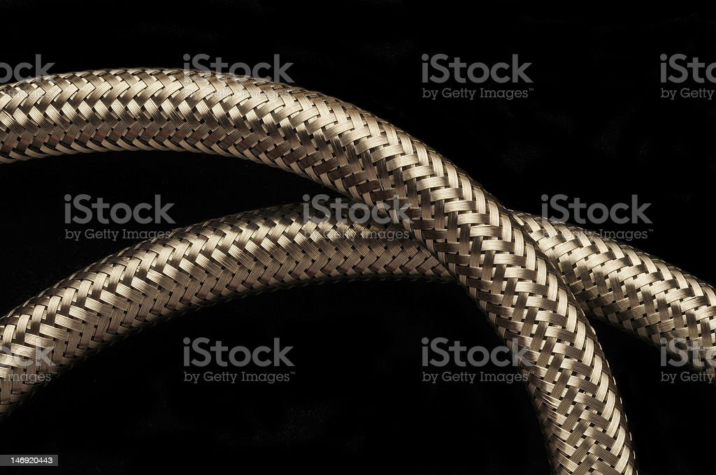 Two flexible stainless steel piping tubes against black royalty-free stock photo