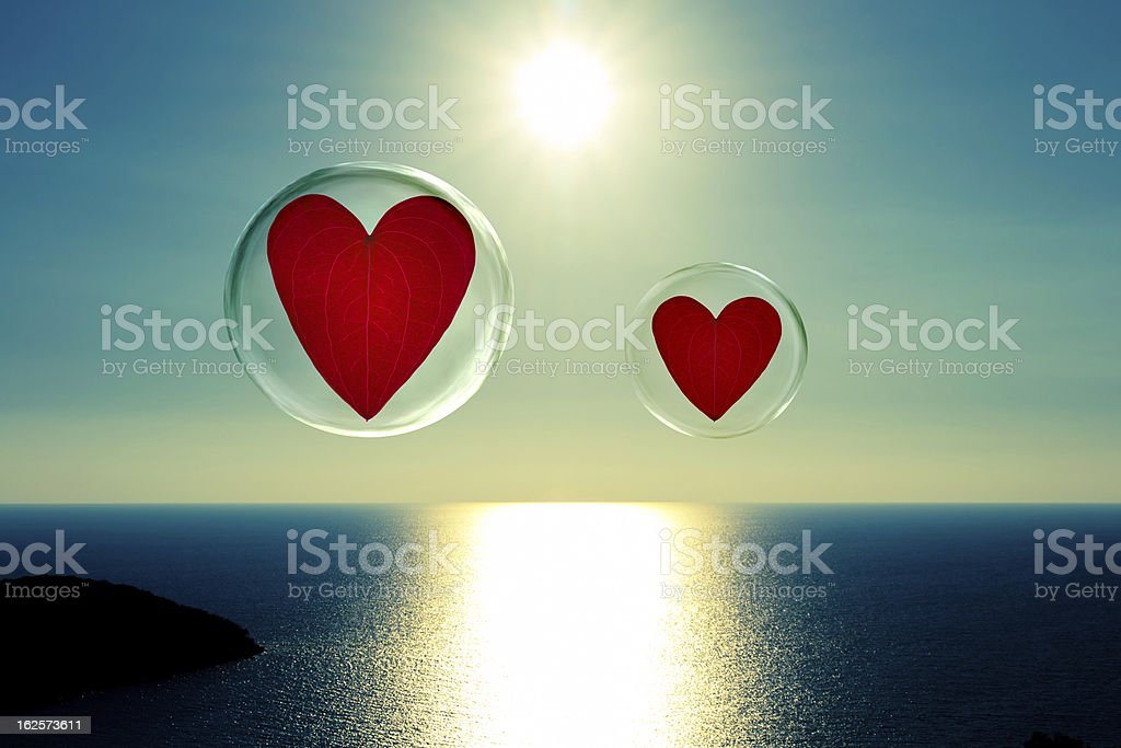 Two floating hearts in bubbles royalty-free stock photo