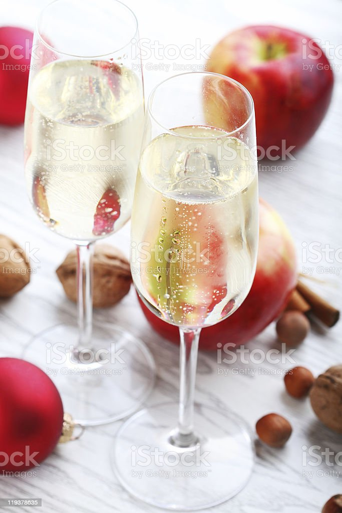 Two flute glasses, apple cider on a table of seasonal decor royalty-free stock photo