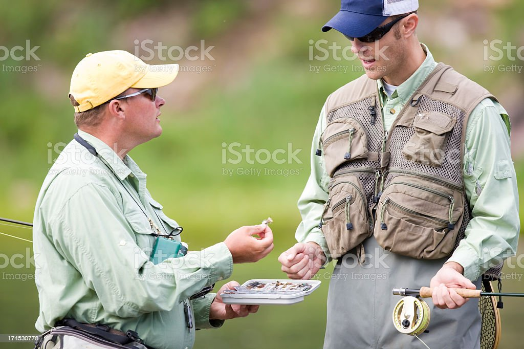 Two Fly Fisherman Discussing Lures royalty-free stock photo