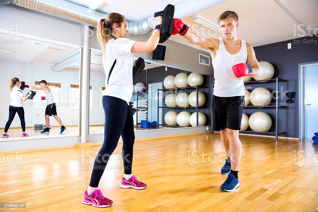 Two focused people training boxing at the fitness gym stock photo