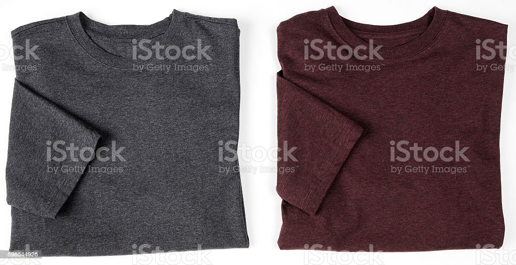 Two Folded gray and burgundy shirts stock photo