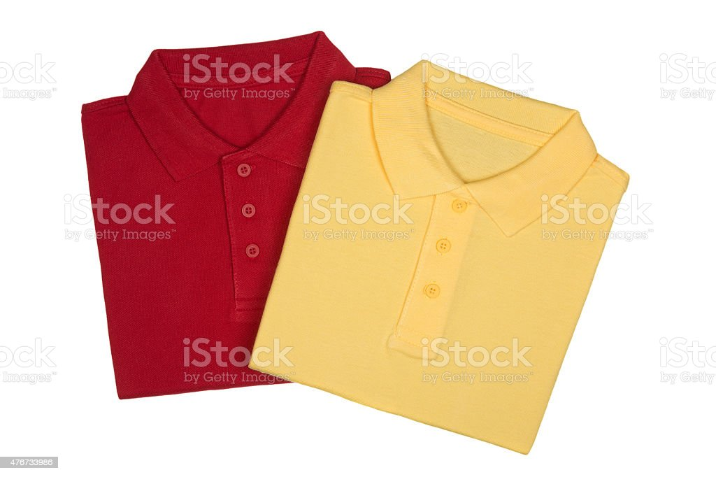 Two folded red and yellow polo shirts isolated on white stock photo