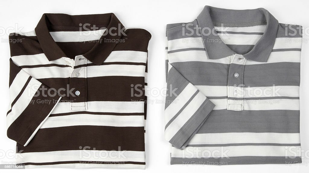 Two Folded striped polo shirts stock photo