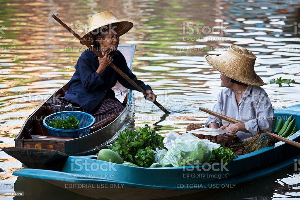 Two food vendors at Damnoen Saduak Floating Market, Thailand. royalty-free stock photo