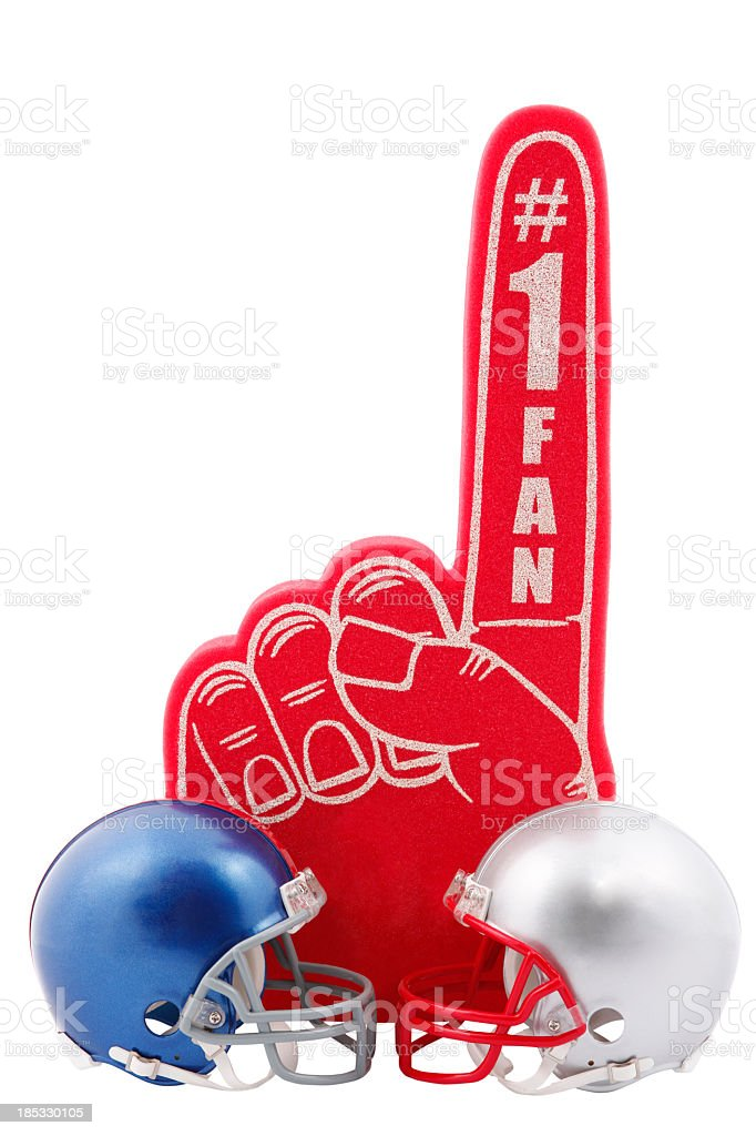 Two Football Helmets with red foam finger stock photo