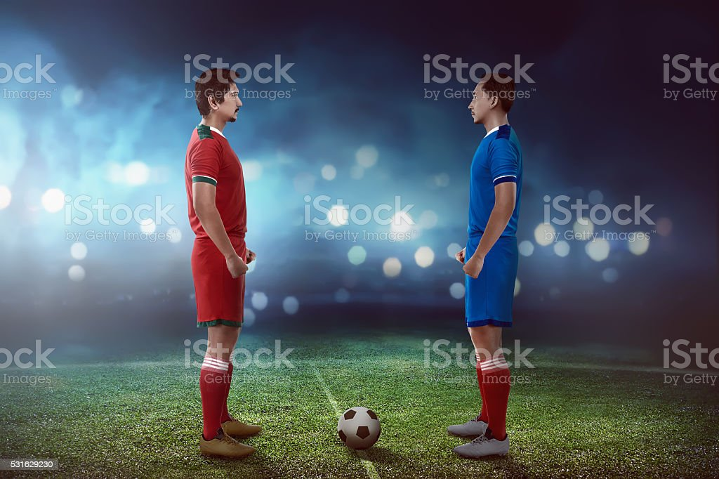 Two football player facing each other stock photo
