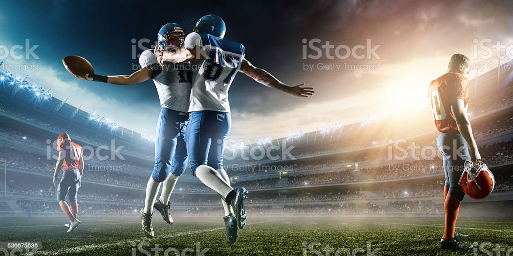 Two Football Players celebrate their victory stock photo