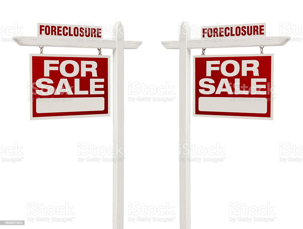 Two Foreclosure For Sale Real Estate Signs with Clipping Path stock photo