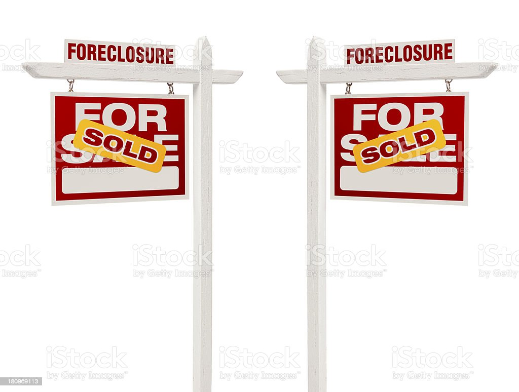 Two Foreclosure Sold For Sale Real Estate Signs, Clipping Path royalty-free stock photo